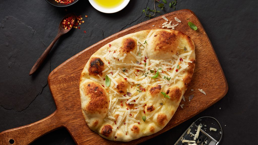 warm naan topped with oil and cheese